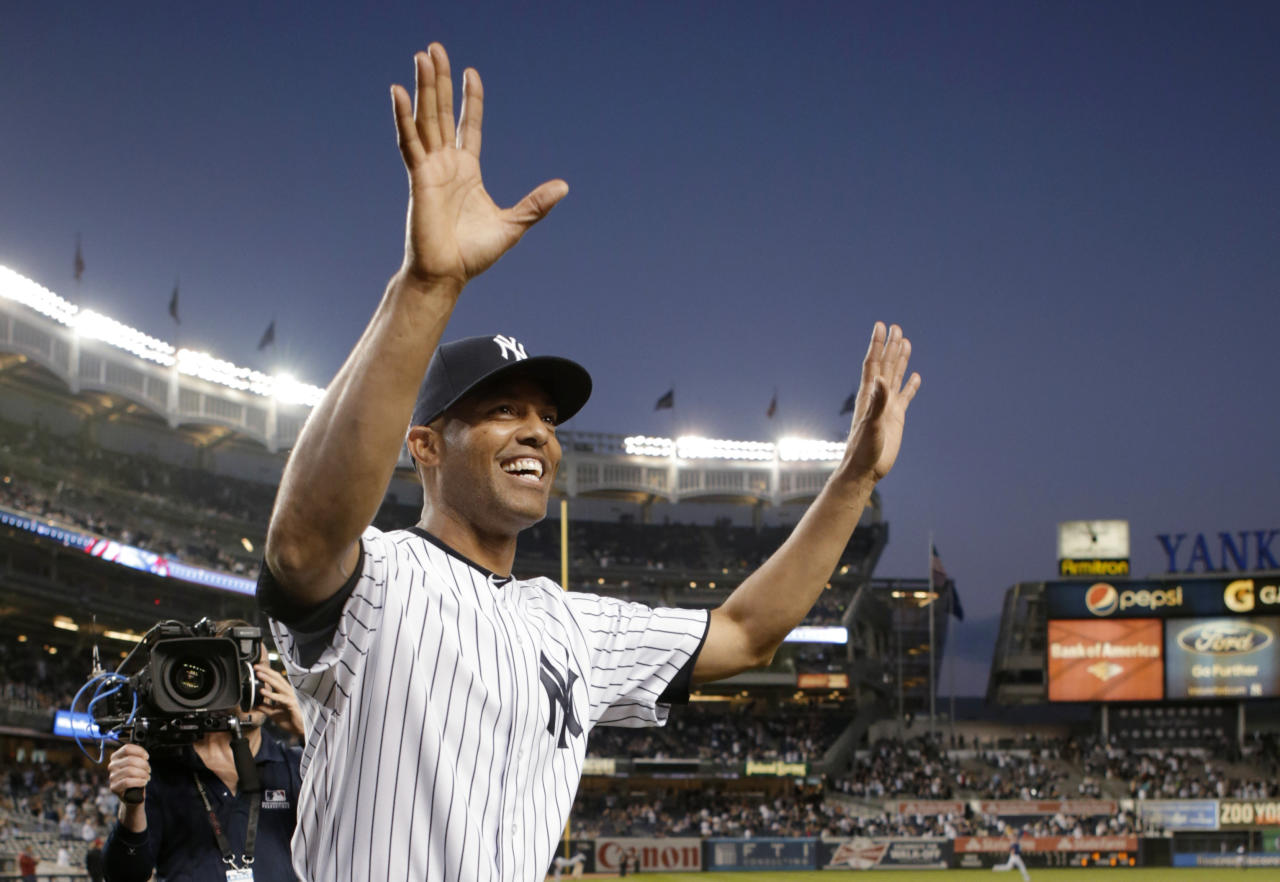 New York Yankees relief pitcher Mariano Rivera acknowledges fans after receiving gifts prior to his final appearance at Yankee Stadium, for a baseball game against the Tampa Bay Rays on Thursday, Sept. 26, 2013, in New York. Rivera is retiring at the end of the season. (AP Photo/Kathy Willens)