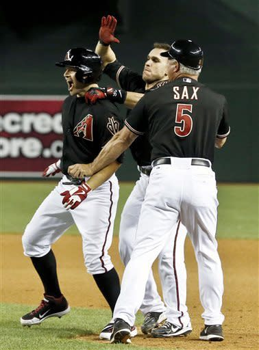 Diamondbacks slip past Rockies in 10