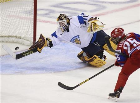 Finland's Raty deflects a shot on net from Russia's Lebedeva during the second period of their bronze medal game at the IIHF Ice Hockey Women's World Championship in Ottawa
