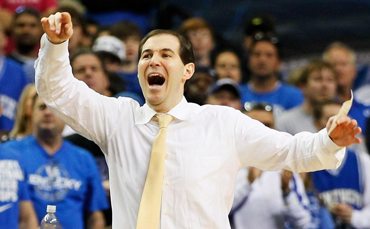 Head coach Scott Drew of the Baylor Bears reacts in the first half against the Kentucky Wildcats during the 2012 NCAA Men's Basketball South Regional Final at the Georgia Dome on March 25, 2012 in Atlanta, Georgia.  (Photo by Kevin C. Cox/Getty Images)
