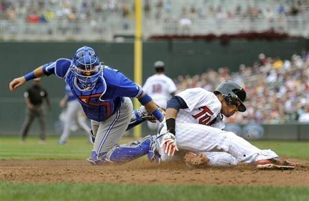 Toronto Blue Jays catcher J.P. Arencibia tags out Minnesota Twins Pedro Florimon at home in the sixth inning of their MLB American League Baseball game in Minneapolis