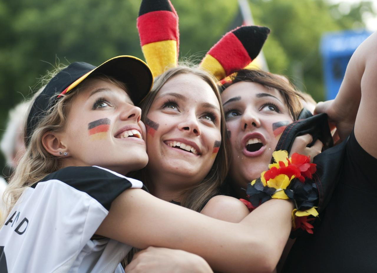 Fans celebrate after the 2014 World Cup quarter-final soccer match between Germany and France at the Fanmeile public viewing arena in Berlin July 4, 2014. REUTERS/Steffi Loos (GERMANY - Tags: SPORT SOCCER WORLD CUP)