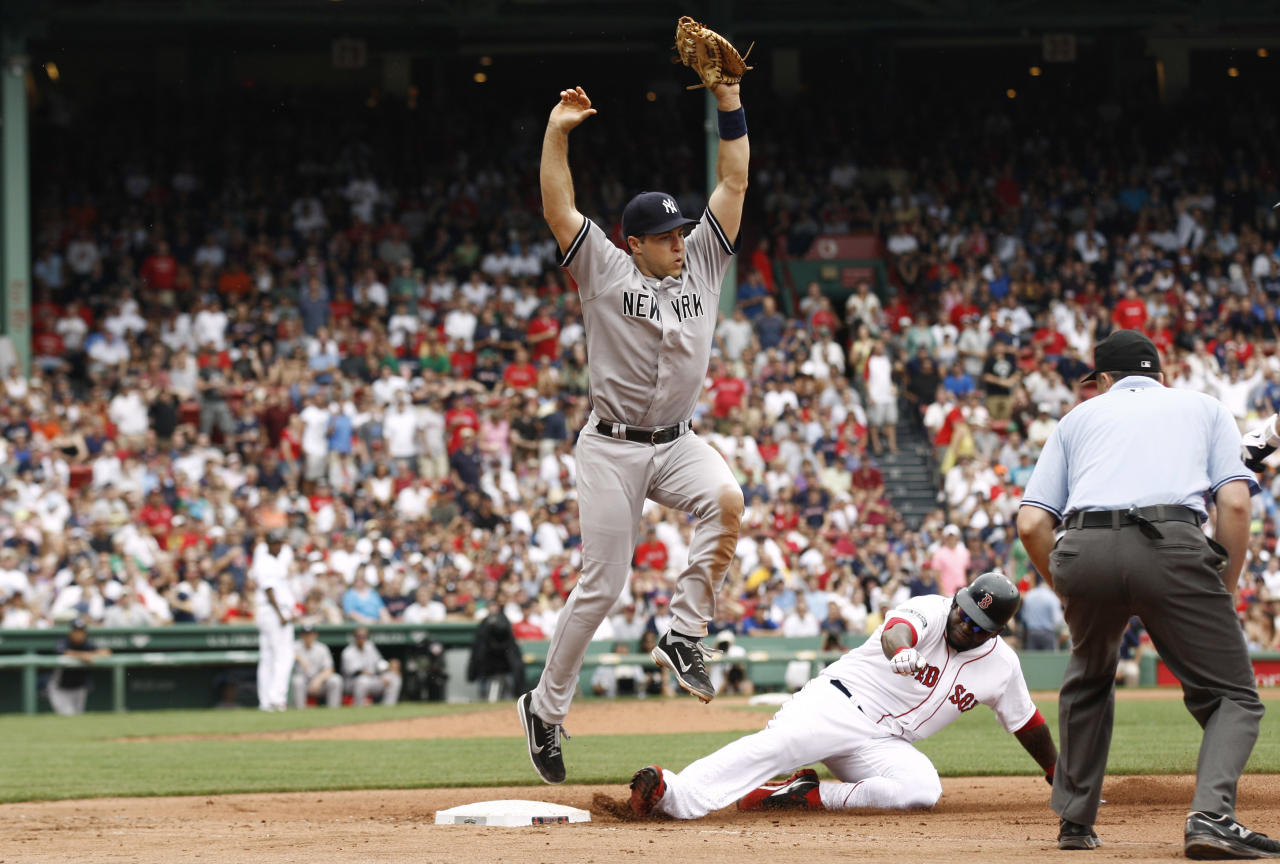 BOSTON, MA - JULY 7: First baseman Mark Teixeira #25 of the New York Yankees leaps to avoid sliding David Ortiz #34 of the Boston Red Sox after Ortiz was doubled off of first during the sIxth inning of game one of a doubleheader at Fenway Park on July 7, 2012 in Boston, Massachusetts. (Photo by Winslow Townson/Getty Images)