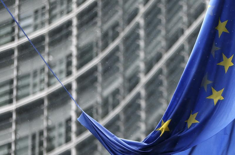 An European Union flag hangs outside the EU Commission headquarters in Brussels