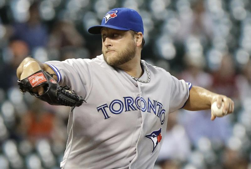 Buehrle sharp as Jays rally past Astros in 9th