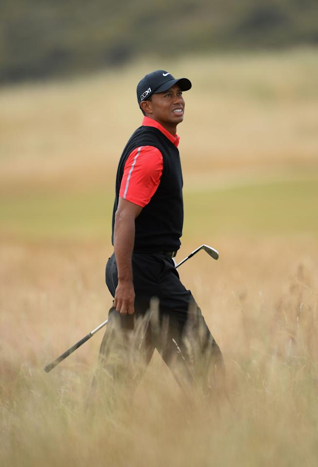 GULLANE, SCOTLAND - JULY 21: Tiger Woods of the United States looks on after he hits a shot on the 3rd hole during the final round of the 142nd Open Championship at Muirfield on July 21, 2013 in Gullane, Scotland. (Photo by Stuart Franklin/Getty Images)