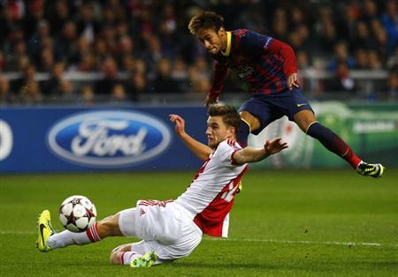 Ajax Amsterdam's Veltman fights for the ball with Barcelona's Neymar during their Champions League soccer match in Amsterdam