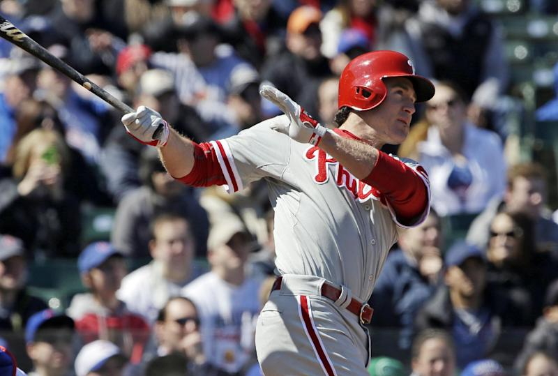 Philadelphia Phillies' Chase Utley watches his solo home run during the first inning of a baseball game against the Chicago Cubs in Chicago, Saturday, April 5, 2014