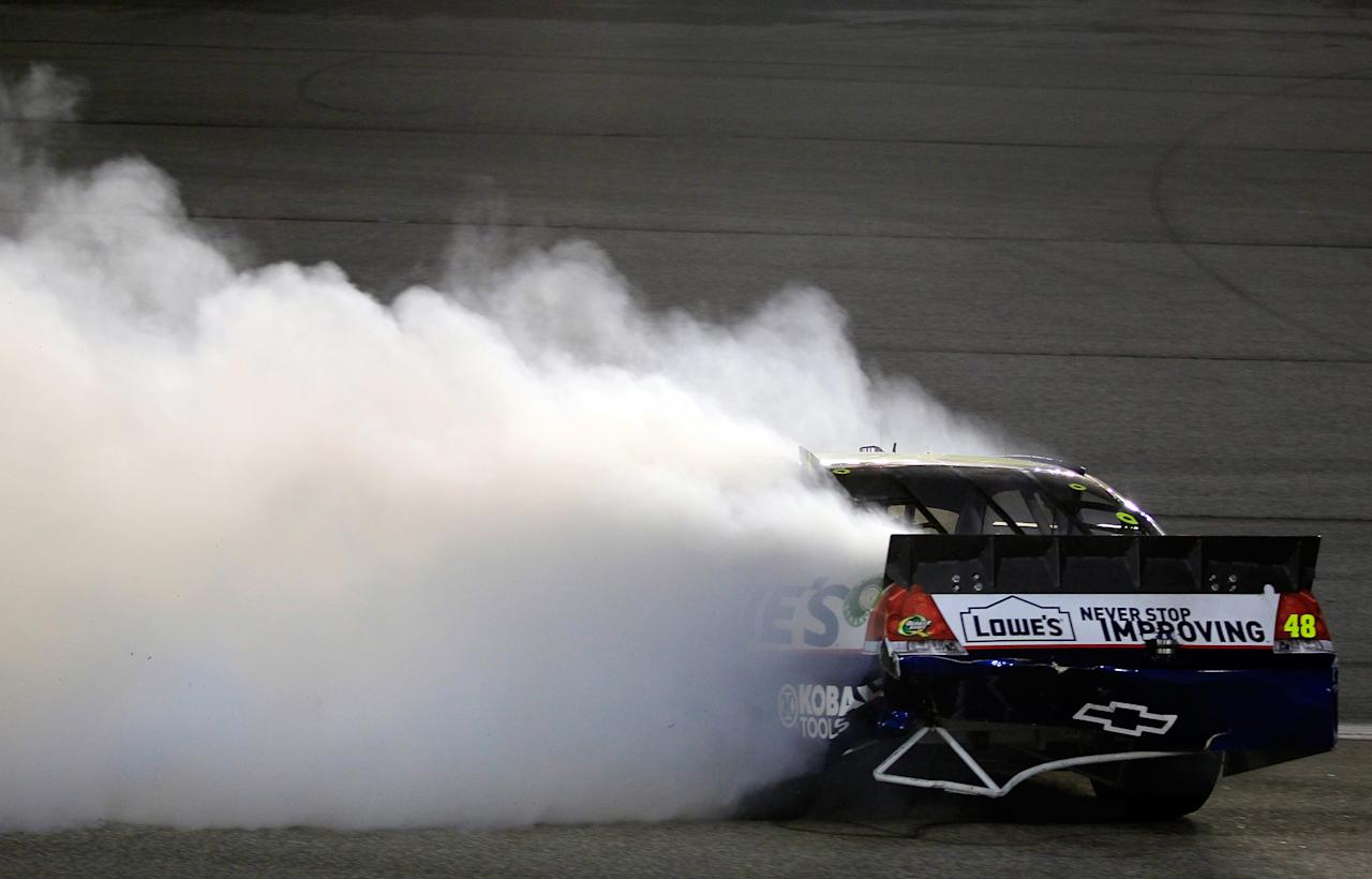 HOMESTEAD, FL - NOVEMBER 20:  Jimmie Johnson, driver of the #48 Lowe's Chevrolet, spins out after an incident in the NASCAR Sprint Cup Series Ford 400 at Homestead-Miami Speedway on November 20, 2011 in Homestead, Florida.  (Photo by Chris Trotman/Getty Images for NASCAR)