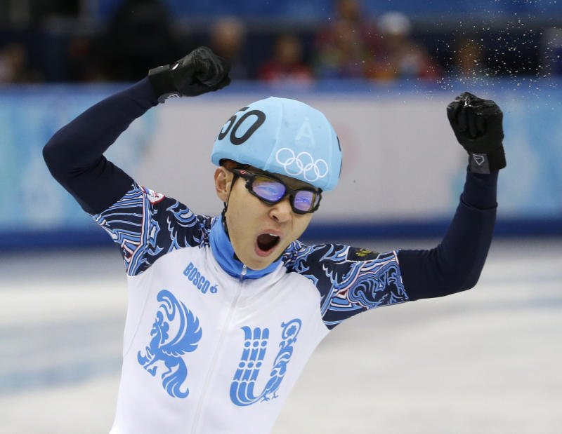 Victor An of Russia reacts after competing in a men's 5000m short track speedskating relay semifinal at the Iceberg Skating Palace during the 2014 Winter Olympics, Thursday, Feb. 13, 2014, in Sochi, Russia