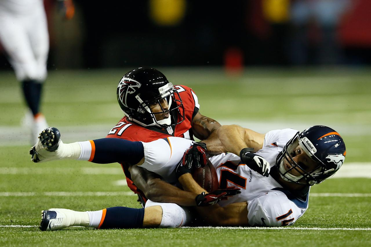 ATLANTA, GA - SEPTEMBER 17:  Wide receiver Brandon Stokley #14 of the Denver Broncos catches a pass against defensive back Chris Owens #21 of the Atlanta Falcons during a game at the Georgia Dome on September 17, 2012 in Atlanta, Georgia.  (Photo by Kevin C. Cox/Getty Images)