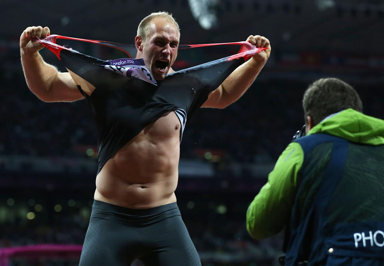 LONDON, ENGLAND - AUGUST 07:  Robert Harting of Germany celebrates winning gold in the Men's Discus Throw Final on Day 11 of the London 2012 Olympic Games at Olympic Stadium on August 7, 2012 in London, England.  (Photo by Quinn Rooney/Getty Images)