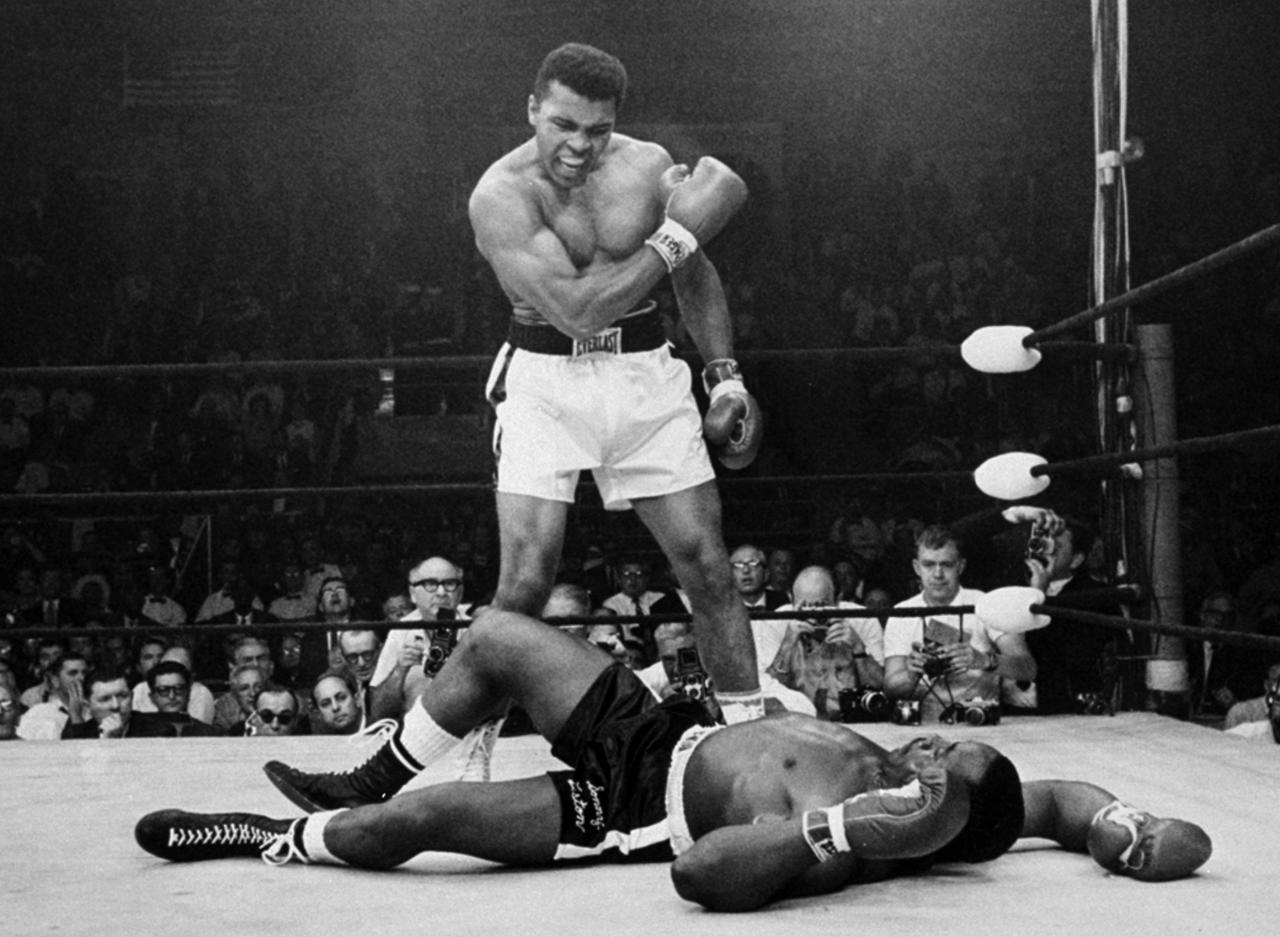 FILE - In this May 25, 1965, file photo, heavyweight champion Muhammad Ali stands over fallen challenger Sonny Liston, after dropping Liston with a short hard right to the jaw in Lewiston, Maine. Ali turns 70 on Jan. 17, 2012.(AP Photo/John Rooney, File)