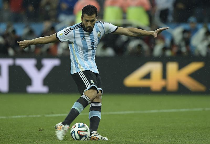 Argentina's defender Ezequiel Garay takes a shot during penalty shoot-outs following extra time during the 2014 FIFA World Cup semi-final match against Netherlands at the Corinthians Arena in Sao Paulo on July 9, 2014