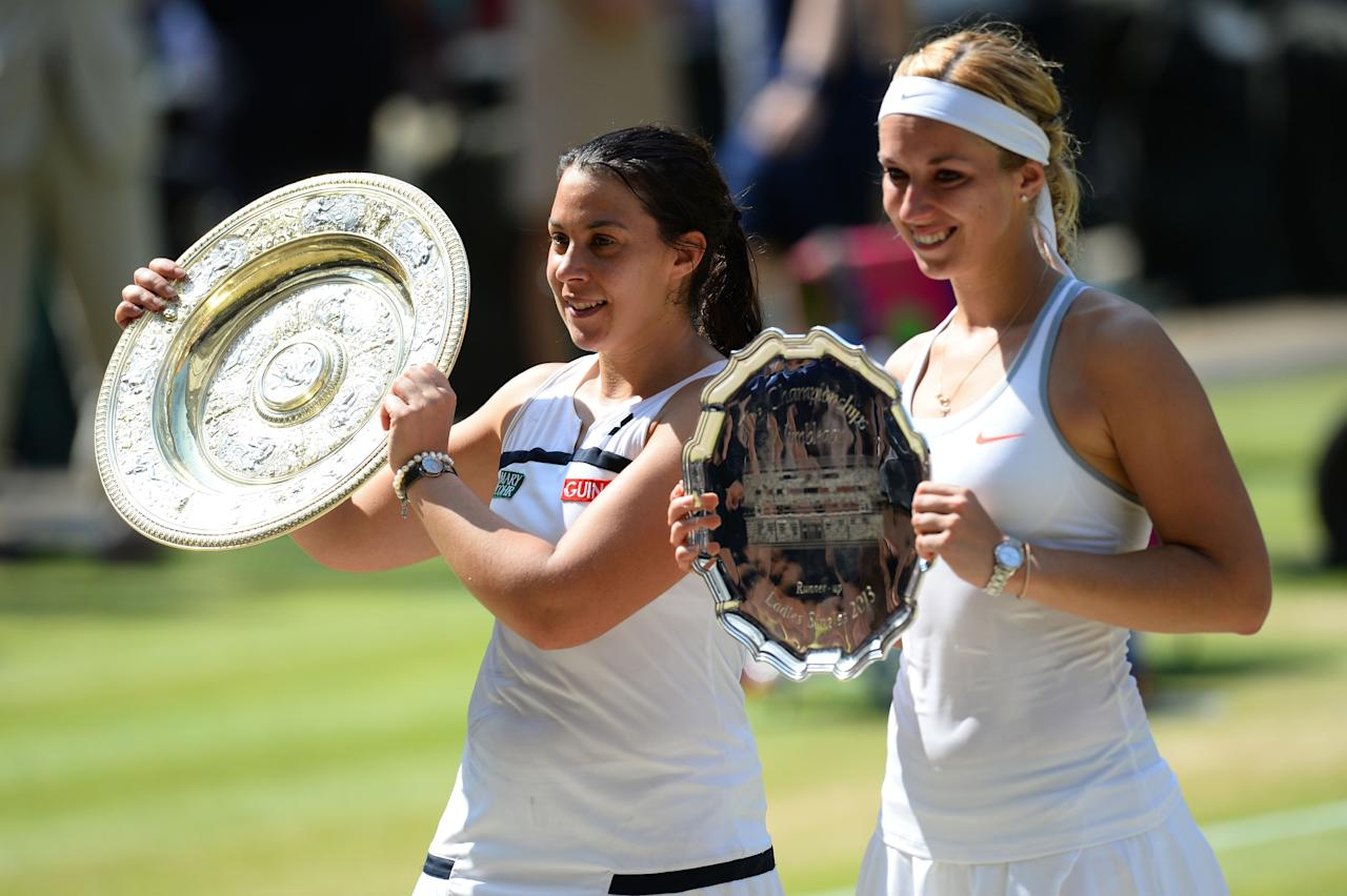 LONDON, ENGLAND - JULY 06: Marion Bartoli of France poses with the Venus Rosewater Dish trophy next to Sabine Lisicki of Germany and her runner-up trophy after their Ladies' Singles final match on day twelve of the Wimbledon Lawn Tennis Championships at the All England Lawn Tennis and Croquet Club on July 6, 2013 in London, England. (Photo by Mike Hewitt/Getty Images)