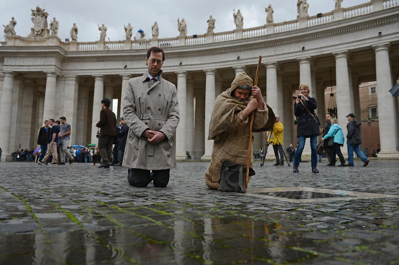 VATICAN CITY, VATICAN - MARCH 12:  Pilgrims gather in St Peter's Square as cardinals attend mass before entering the conclave on March 12, 2013 in Vatican City, Vatican. Pope Benedict XVI's successor is being chosen by the College of Cardinals in Conclave in the Sistine Chapel. The 115 cardinal-electors, meeting in strict secrecy, will need to reach a two-thirds-plus-one vote majority to elect the 266th Pontiff..  (Photo by Jeff J Mitchell/Getty Images)