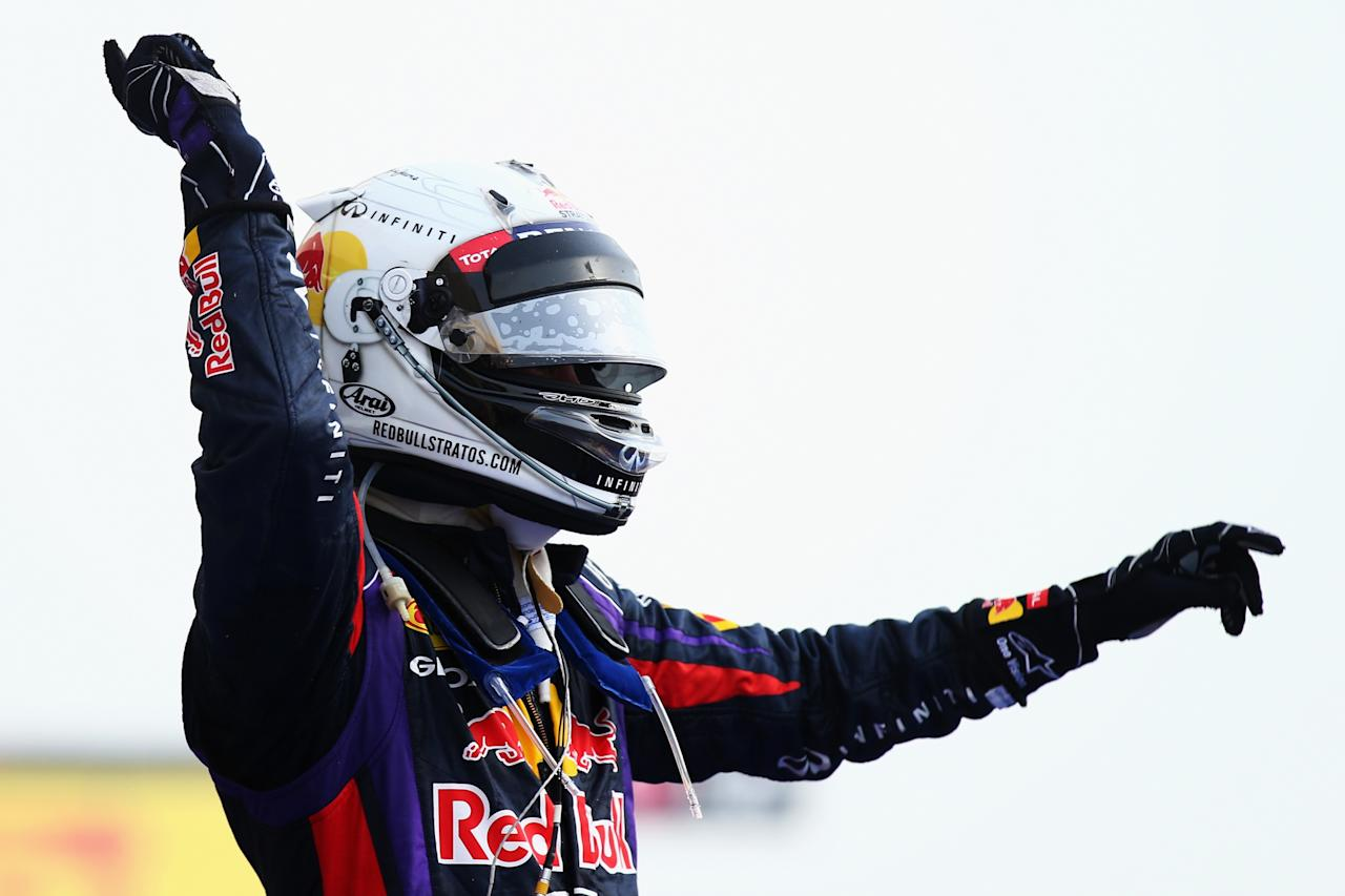 SAKHIR, BAHRAIN - APRIL 21:  Sebastian Vettel of Germany and Infiniti Red Bull Racing celebrates in parc ferme after winning the Bahrain Formula One Grand Prix at the Bahrain International Circuit on April 21, 2013 in Sakhir, Bahrain.  (Photo by Clive Mason/Getty Images)