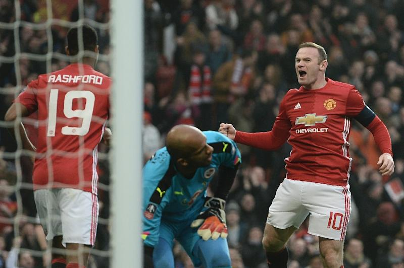 Wayne Rooney celebrates after equalling Bobby Charlton's Manchester United all-time scoring record during the English FA Cup third round match against Reading at Old Trafford