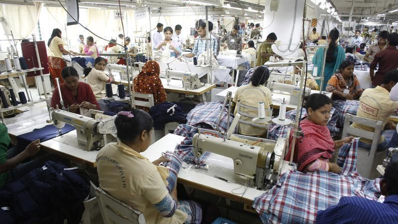 Employees work in a factory of Babylon Garments in Dhaka