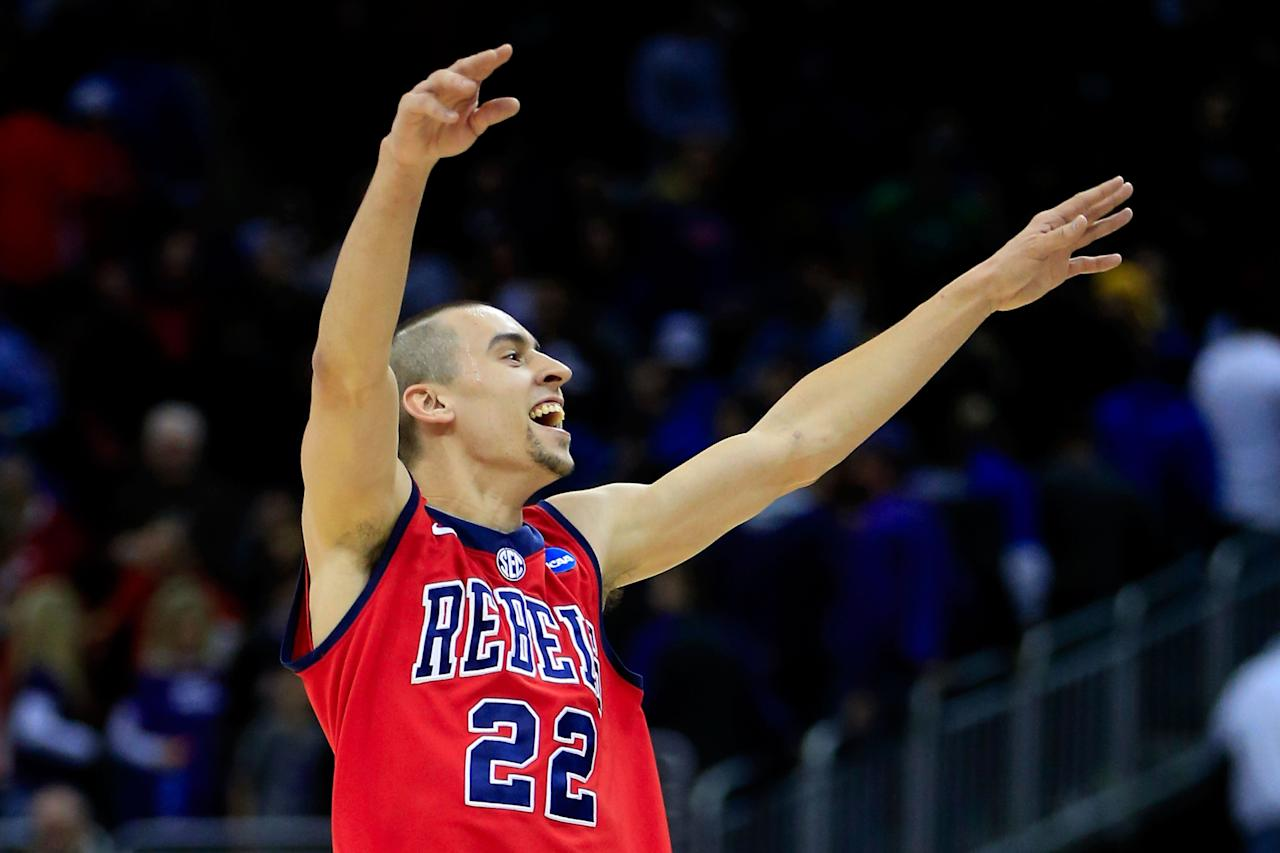 KANSAS CITY, MO - MARCH 22:  Marshall Henderson #22 of the Ole Miss Rebels celebrates their 57-46 win over the Wisconsin Badgers during the second round of the 2013 NCAA Men's Basketball Tournament at the Sprint Center on March 22, 2013 in Kansas City, Missouri.  (Photo by Jamie Squire/Getty Images)