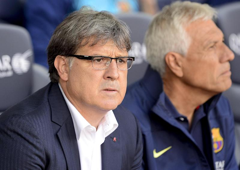 "Barcelona's Argentinian coach Gerardo ""Tata"" Martino looks on during the Spanish league football match FC Barcelona vs Club Atletico de Madrid at the Camp Nou stadium in Barcelona on May 17, 2014"