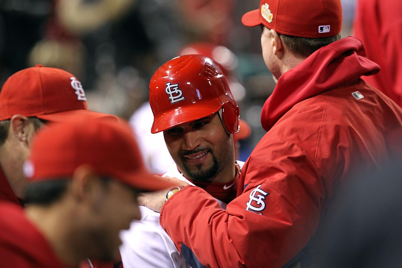 ST LOUIS, MO - OCTOBER 28:  Albert Pujols #5  of the St. Louis Cardinals celebrates in the dugout after scoring on a Rafael Furcal #15 hit by pitch with the bases loaded in the fifth inning during Game Seven of the MLB World Series at Busch Stadium on October 28, 2011 in St Louis, Missouri.  (Photo by Jamie Squire/Getty Images)