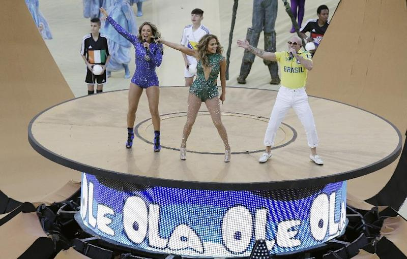 Brazilian singer Claudia Leitte, left, US singer Jennifer Lopez and rapper Pitbull perform during the opening ceremony ahead of the group A World Cup soccer match between Brazil and Croatia, the opening game of the tournament, in the Itaquerao Stadium in Sao Paulo, Brazil, Thursday, June 12, 2014