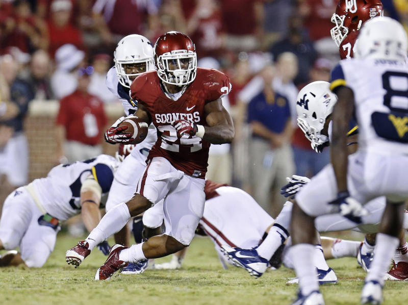 Clay leads No. 16 Oklahoma past West Virginia 16-7