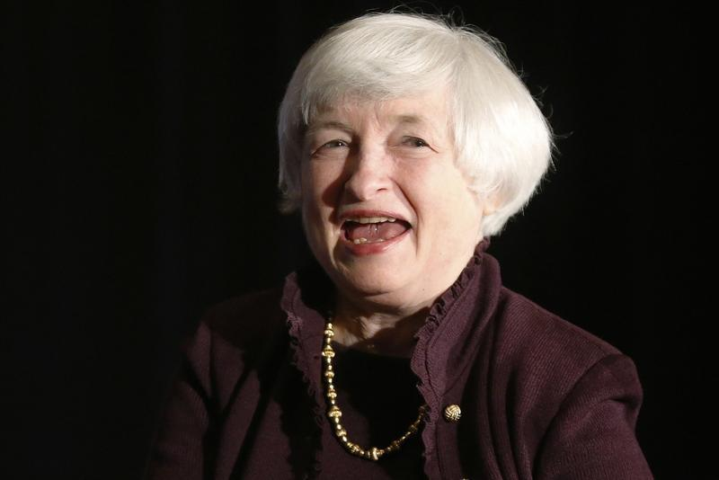 Yellen smiles during applause after her speech before the Independent Community Bankers of America 2014 Washington Policy Summit in Washington