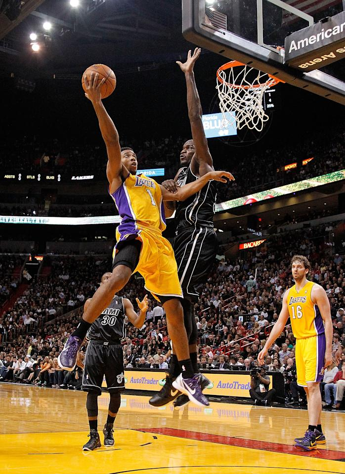MIAMI, FL - JANUARY 19: Darius Morris #1 of the Los Angeles Lakers drives against Joel Anthony #50 of the Miami Heat during a game  at American Airlines Arena on January 19, 2012 in Miami, Florida. NOTE TO USER: User expressly acknowledges and agrees that, by downloading and/or using this Photograph, User is consenting to the terms and conditions of the Getty Images License Agreement.  (Photo by Mike Ehrmann/Getty Images)