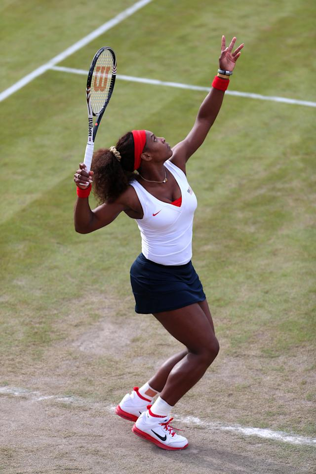 LONDON, ENGLAND - JULY 30:  Serena Williams of the United States serves during her Women's Doubles Tennis match against Sorana Cirstea and Simona Halep of Romania on Day 3 of the London 2012 Olympic Games at the All England Lawn Tennis and Croquet Club in Wimbledon on July 30, 2012 in London, England.  (Photo by Clive Brunskill/Getty Images)