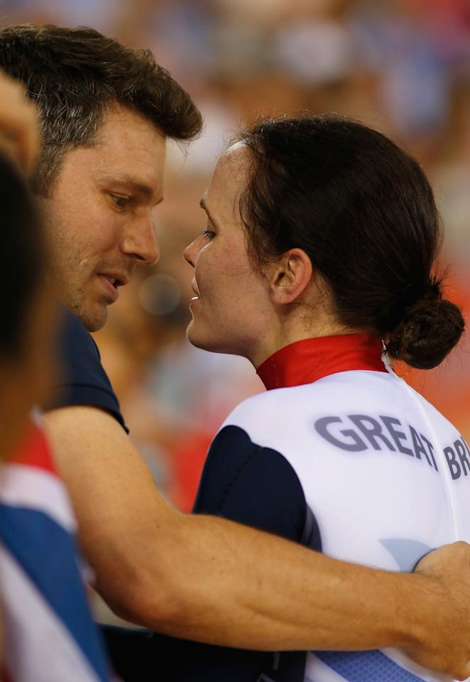 LONDON, ENGLAND - AUGUST 03:  Victoria Pendleton of Great Britain celebrates with her fiance Scott Gardner after winning gold in the Women's Keirin Track Cycling final on Day 7 of the London 2012 Olympic Games at Velodrome on August 3, 2012 in London, England.  (Photo by Jamie Squire/Getty Images)