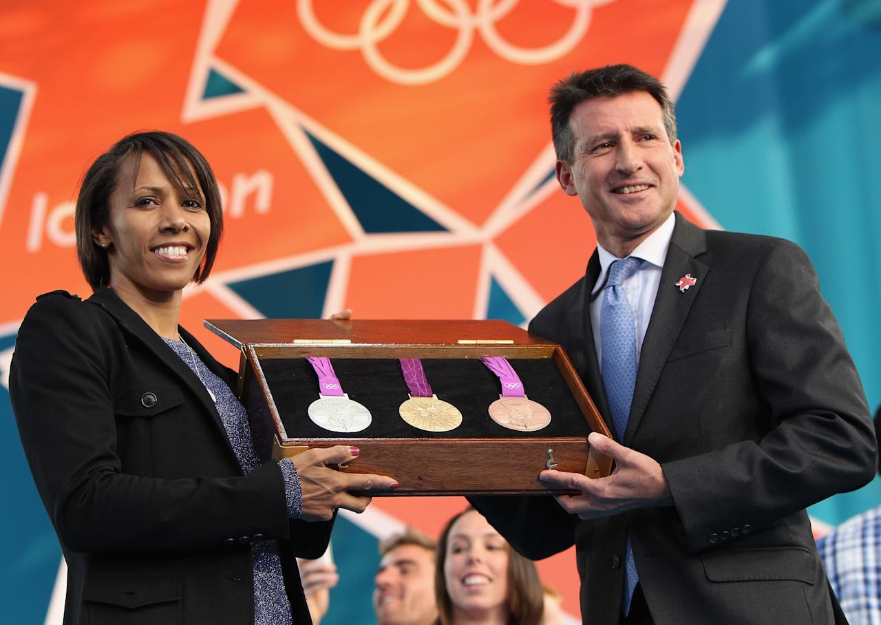 LONDON, ENGLAND - JULY 27:  Dame Kelly Holmes and LOCOG Chairman Sebastian Coe present the olympic medals during  the' London 2012 - One Year To Go' ceremony in Trafalgar Square on July 27, 2011 in London, England. The one year countdown to the London 2012 Olympic games was marked with a unique ceremony in Trafalgar Square, with IOC President Jacques Rogge inviting the world's athletes to compete in next summer's games.  (Photo by Dan Kitwood/Getty Images)