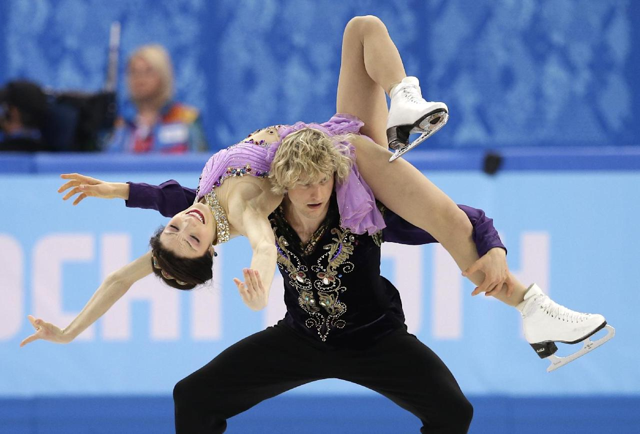 Meryl Davis and Charlie White of the United States compete in the ice dance free dance figure skating finals at the Iceberg Skating Palace during the 2014 Winter Olympics, Monday, Feb. 17, 2014, in Sochi, Russia. (AP Photo/Darron Cummings)