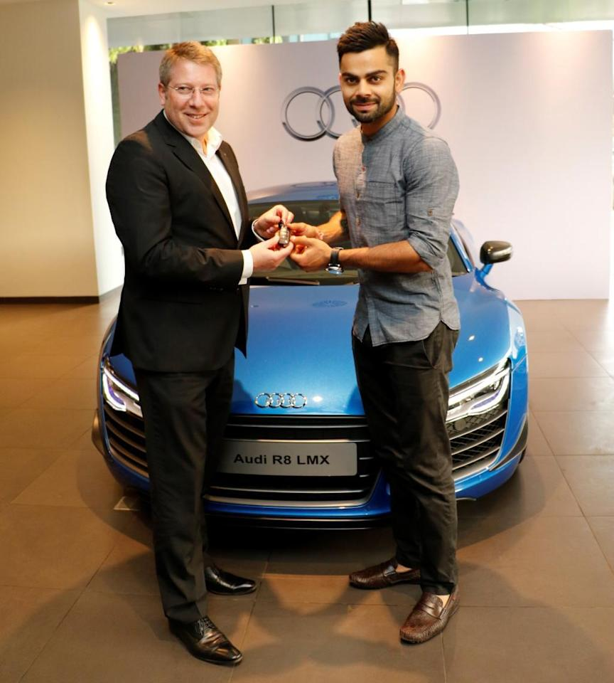 Mumbai: Indian Cricketer Virat Kohli and Joe King, Head Audi India  takes delivery of the limited edition Audi R8 LMX super sports car in Mumbai on  7th May, 2015 (Photo: IANS)