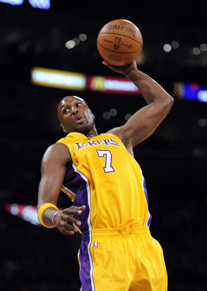 In this photo taken Oct. 16, 2010, Los Angeles Lakers forward Lamar Odom goes up for a shot during the first half of their preseason NBA basketball game against the Denver Nuggets in Los Angeles. The Lakers have acquired the Dallas Mavericks' first-round selection in the 2012 NBA Draft in exchange for Odom and the Lakers' 2012 second-round draft pick, it was announced on Sunday, Dec. 11, 2011, by general manager Mitch Kupchak. In addition, the Lakers will receive a trade exception. (AP Photo/Mark J. Terrill)