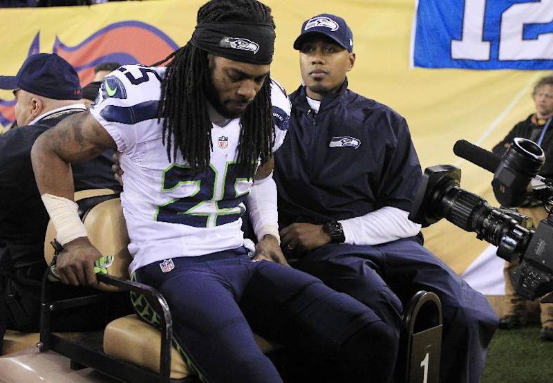Sherman leaves with apparent right leg injury