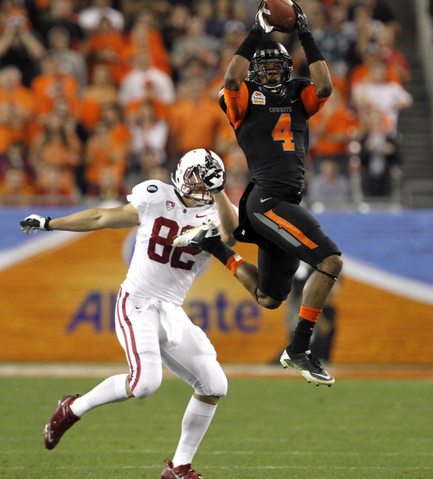 Oklahoma State cornerback Justin Gilbert (4) intercepts a pass intended for Stanford tight end Coby Fleener (82) during the first half of the Fiesta Bowl NCAA college football game Monday, Jan. 2, 2012, in Glendale, Ariz. (AP Photo/Ross D. Franklin)