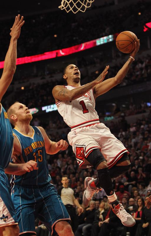 CHICAGO, IL - FEBRUARY 28:  Derrick Rose #1 of the Chicago Bulls drives to the basket past Chris Kaman #35 of the New Orleans Hornets on his way to a game-high 32 points at the United Center on February 28, 2012 in Chicago, Illinois. The Bulls defeated the Hornets 99-95. NOTE TO USER: User expressly acknowledges and agrees that, by downloading and or using this photograph, User is consenting to the terms and conditions of the Getty Images License Agreement.  (Photo by Jonathan Daniel/Getty Images)