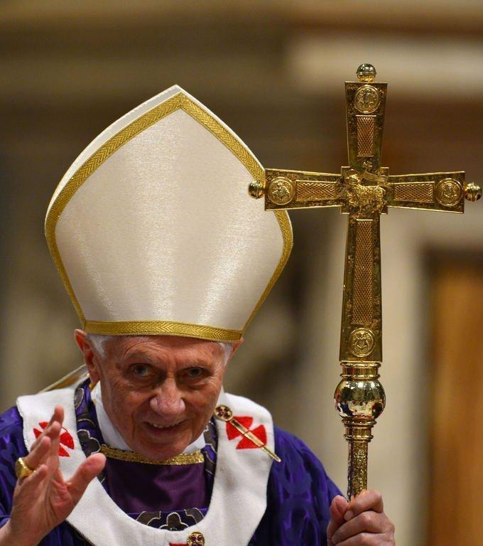 "Pope Benedict XVI waves after celebrating Mass on February 13, 2013 at the Vatican. His final homily was a hard-hitting one. He condemned the ""hypocrisy"" of those who use their religion just for show and urged an end to ""rivalry"" and ""divisions"" within a Church that has been plagued in recent years by a series of scandals"
