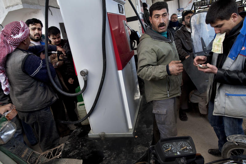 Syrians struggle with shortages as economy buckles