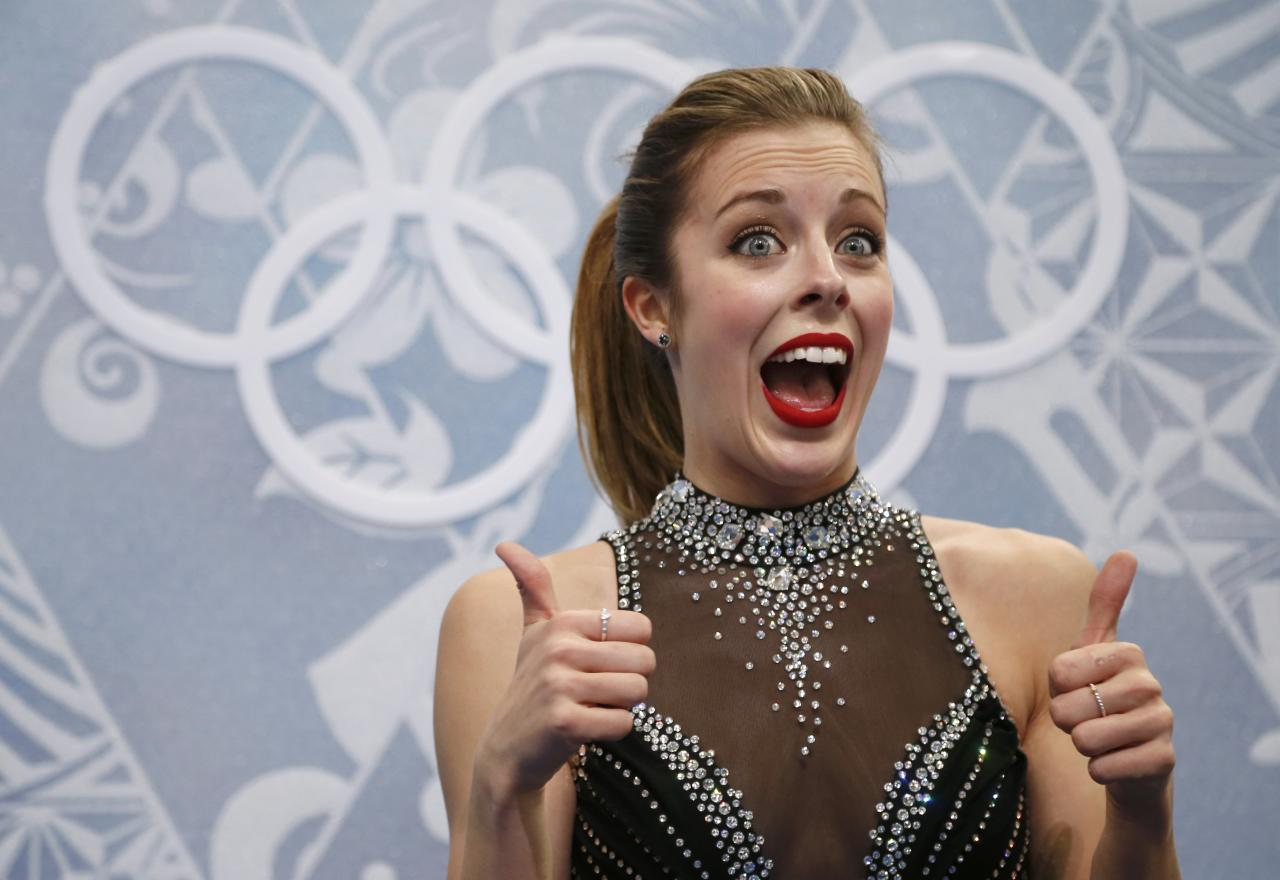 "Ashley Wagner of the U.S. reacts in the ""kiss and cry"" area during the Figure Skating Women's Short Program at the Sochi 2014 Winter Olympics, February 19, 2014. REUTERS/Lucy Nicholson (RUSSIA - Tags: OLYMPICS SPORT FIGURE SKATING)"