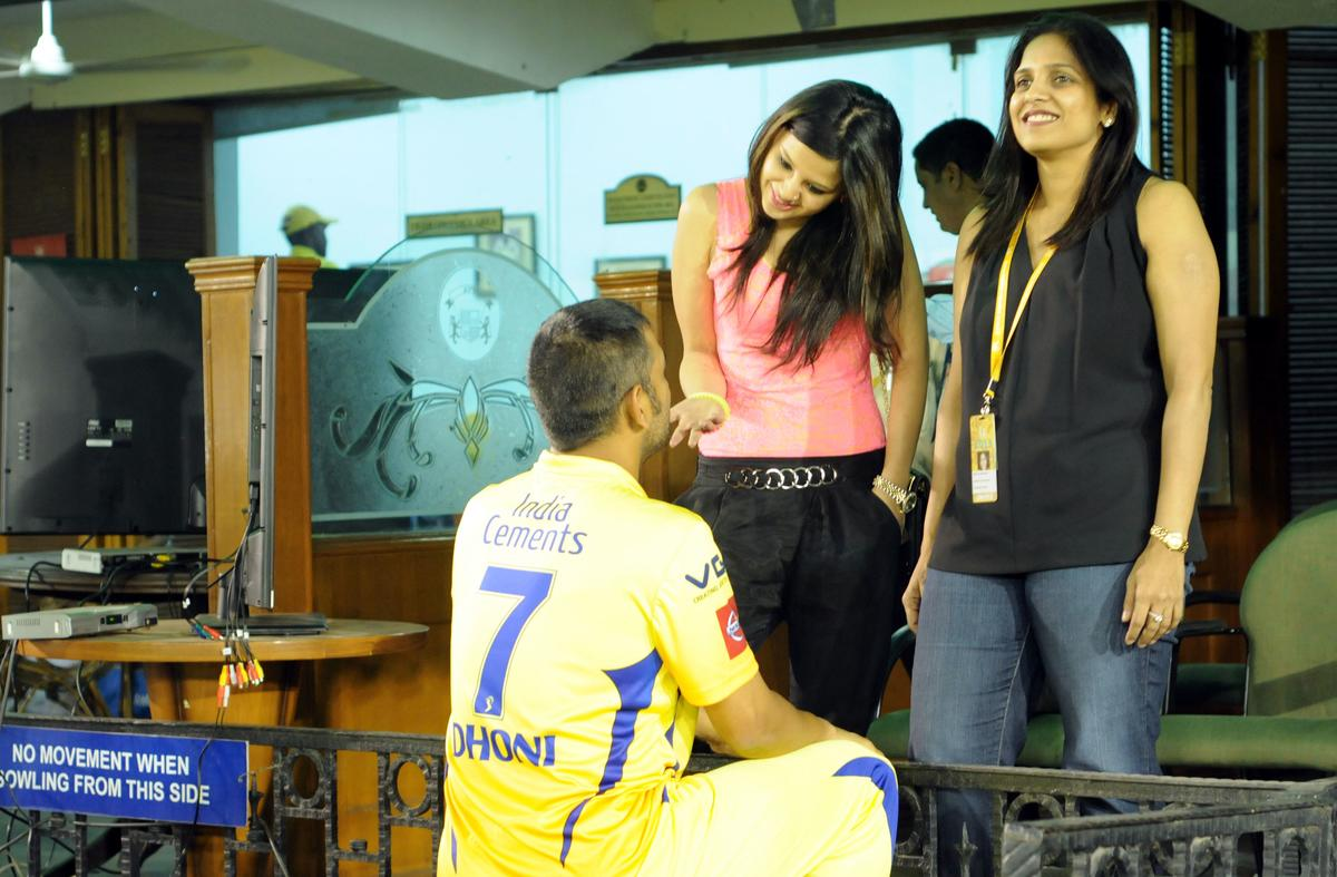 CSK captian MS DHONI and wife sakshi react after match 11 of of the Pepsi Indian Premier League between The Kings XI Punjab and the Chennai Superkings held at the PCA Stadium, Mohal, India  on the 10th April 2013..Photo by Arjun Panwar-IPL-SPORTZPICS   ..Use of this image is subject to the terms and conditions as outlined by the BCCI. These terms can be found by following this link:..http://www.sportzpics.co.za/image/I0000SoRagM2cIEc