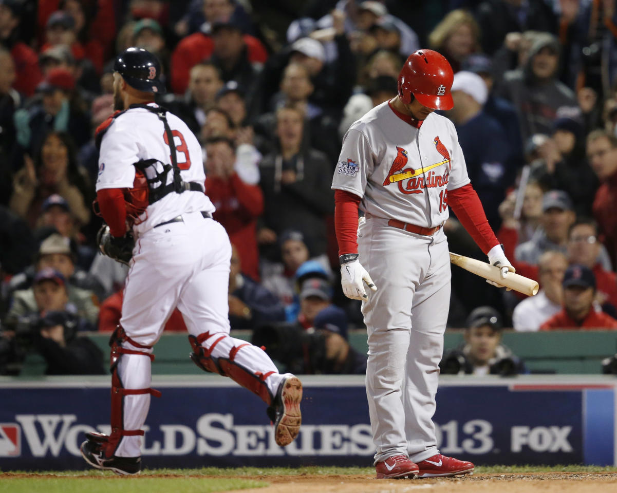 St. Louis Cardinals' Jon Jay reacts after striking out, as Boston Red Sox's David Ross runs to the dugout during the eighth inning of Game 1 of baseball's World Series Wednesday, Oct. 23, 2013, in Boston. (AP Photo/Elise Amendola)