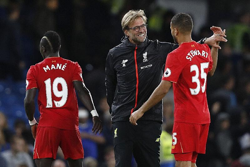Liverpool's manager Jurgen Klopp (C) celebrates with Liverpool's midfielder Sadio Mane (L) and Liverpool's defender Kevin Stewart during the English Premier League football match against Chelsea September 16, 2016