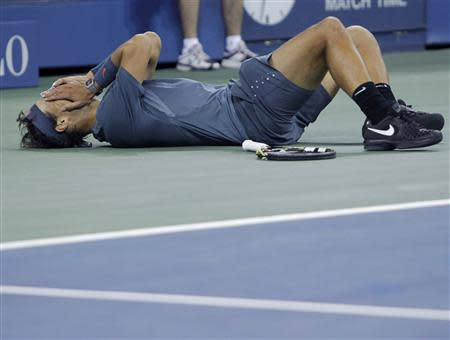 Nadal of Spain celebrates after defeating Djokovic of Serbia in their men's final match at the U.S. Open tennis championships in New York