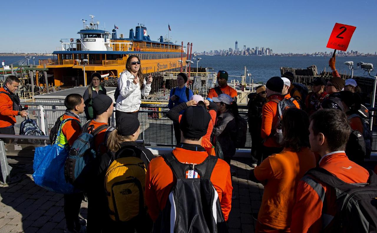 Runners prepare to board the Staten Island with goods and supplies for Superstorm Sandy victims, Sunday, Nov. 4, 2012 in New York. With the cancellation of the New York Marathon, hundreds of runners, wearing their marathon shirts and backpacks full of supplies, took the ferry to hard-hit Staten Island and ran to neighborhoods hard hit by Superstorm Sandy to help. (AP Photo/Craig Ruttle)