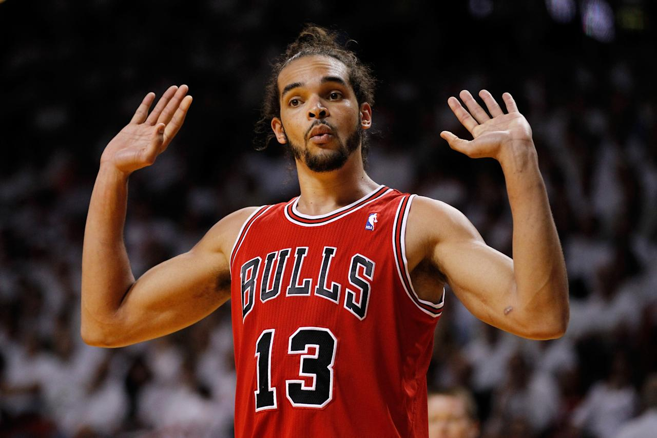 MIAMI, FL - MAY 06:  Joakim Noah #13 of the Chicago Bulls reacts following a play against the Miami Heat during Game One of the Eastern Conference Semifinals of the 2013 NBA Playoffs at American Airlines Arena on May 6, 2013 in Miami, Florida. NOTE TO USER: User expressly acknowledges and agrees that, by downloading and/or using this photograph, user is consenting to the terms and conditions of the Getty Images License Agreement.  (Photo by Chris Trotman/Getty Images)