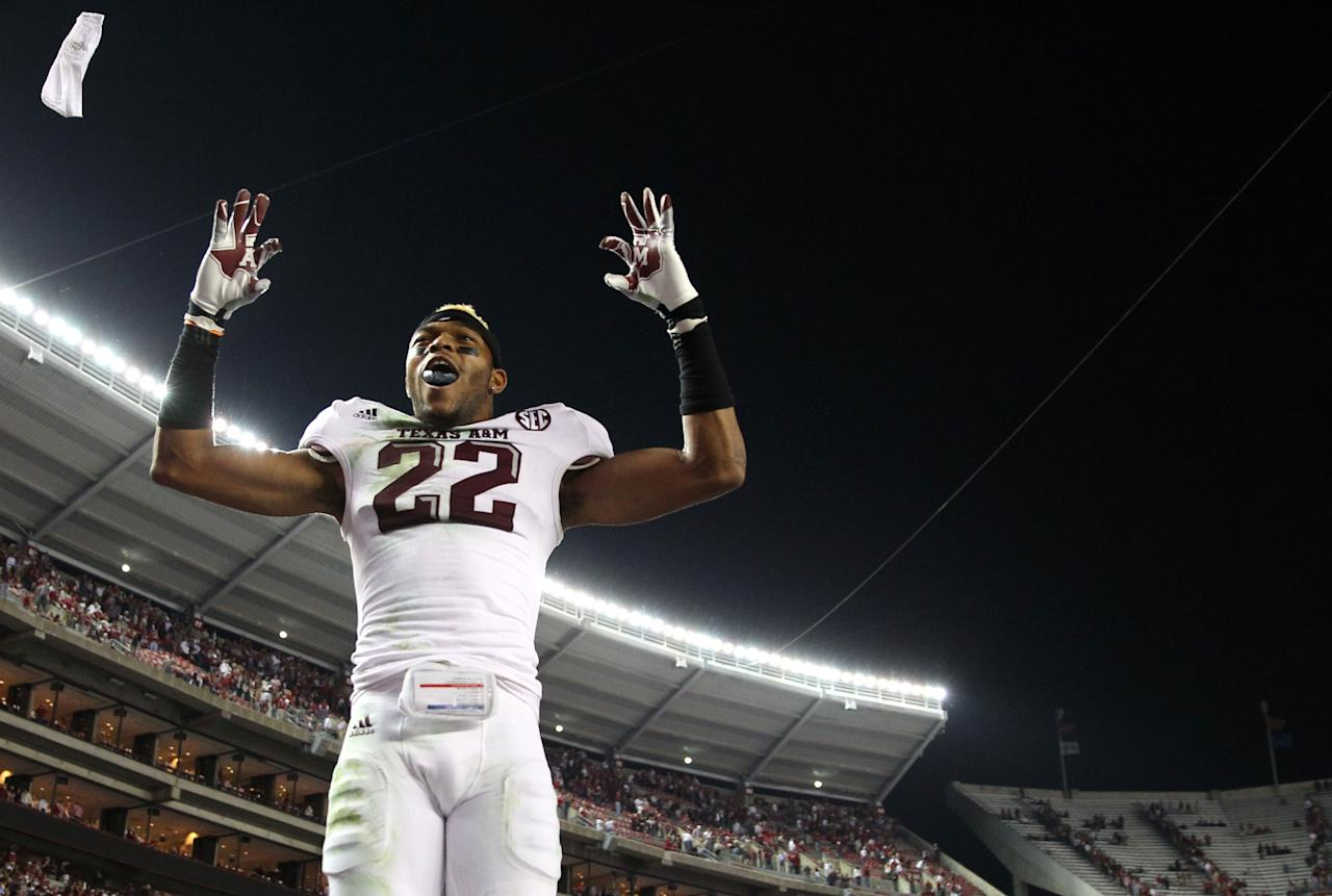 TUSCALOOSA, AL - NOVEMBER 10:  Defensive back Dustin Harris #22 of the Texas A&M Aggies celebrates after the game against the Alabama Crimson Tide at Bryant-Denny Stadium on November 10, 2012 in Tuscaloosa, Alabama.  The Aggies beat the Crimson Tide 29-24.  (Photo by Mike Zarrilli/Getty Images)