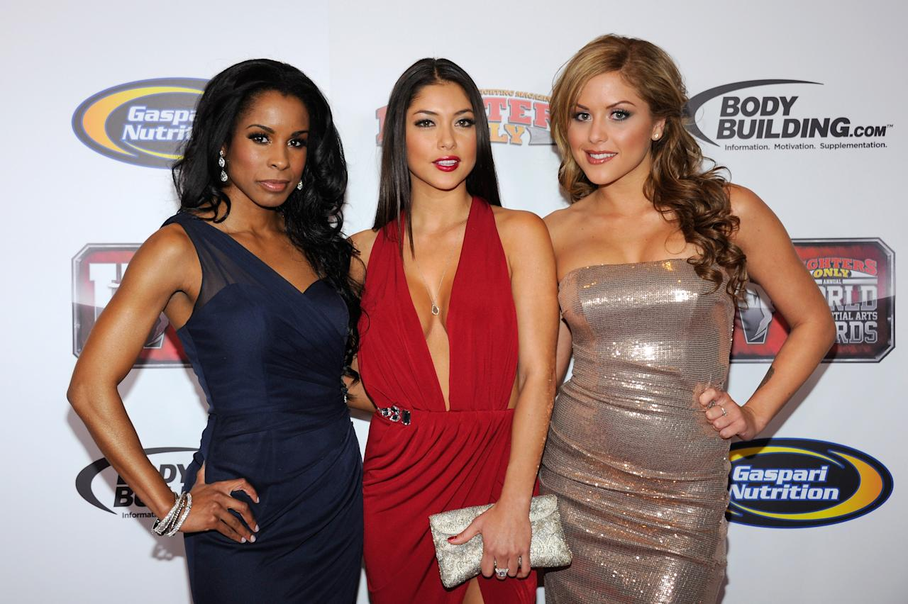 LAS VEGAS, NV - NOVEMBER 30:  UFC Octogon girls Chandella Powell, Arianny Celeste and Brittney Palmer arrive at the Fighters Only World Mixed Martial Arts Awards 2011 at the Palms Casino Resort November 30, 2011 in Las Vegas, Nevada.  (Photo by Ethan Miller/Getty Images)
